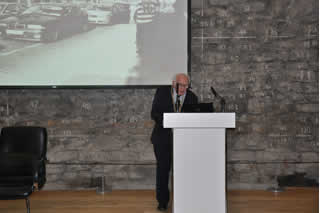 John Gallagher delivered the opening speech at the foot of the old city walls. Photos from local peoples personal collections were projected on the large screen behind him.